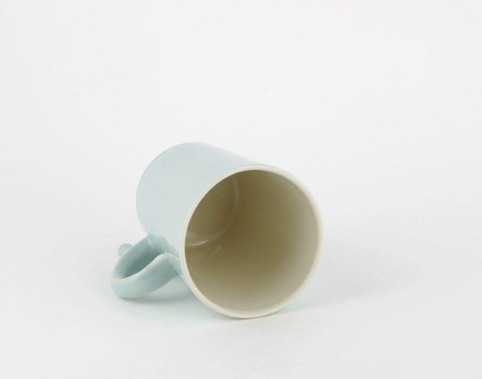 blaue Tasse mit Stopper